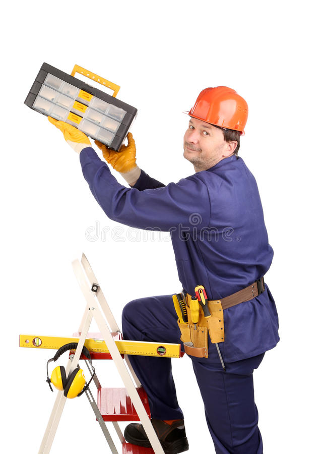 Arbeitskraft auf Leiter mit Hammer lizenzfreies stockfoto