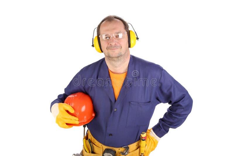 Arbeitskraft in den Ohrmuffen und -gläsern. stockfotografie