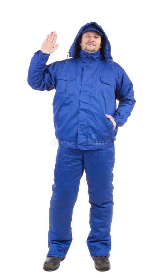 Arbeitskraft in der blauen Arbeitskleidung lizenzfreie stockfotografie