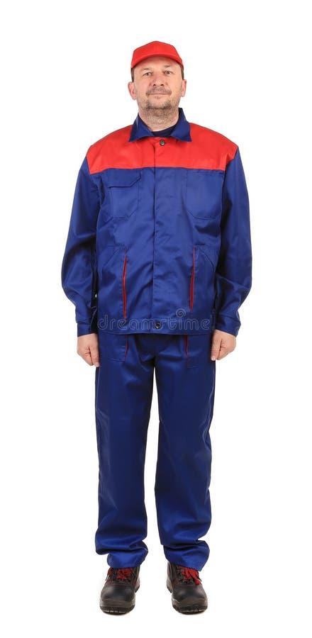 Arbeitskraft in der rot-blauen Arbeitskleidung. lizenzfreie stockfotos