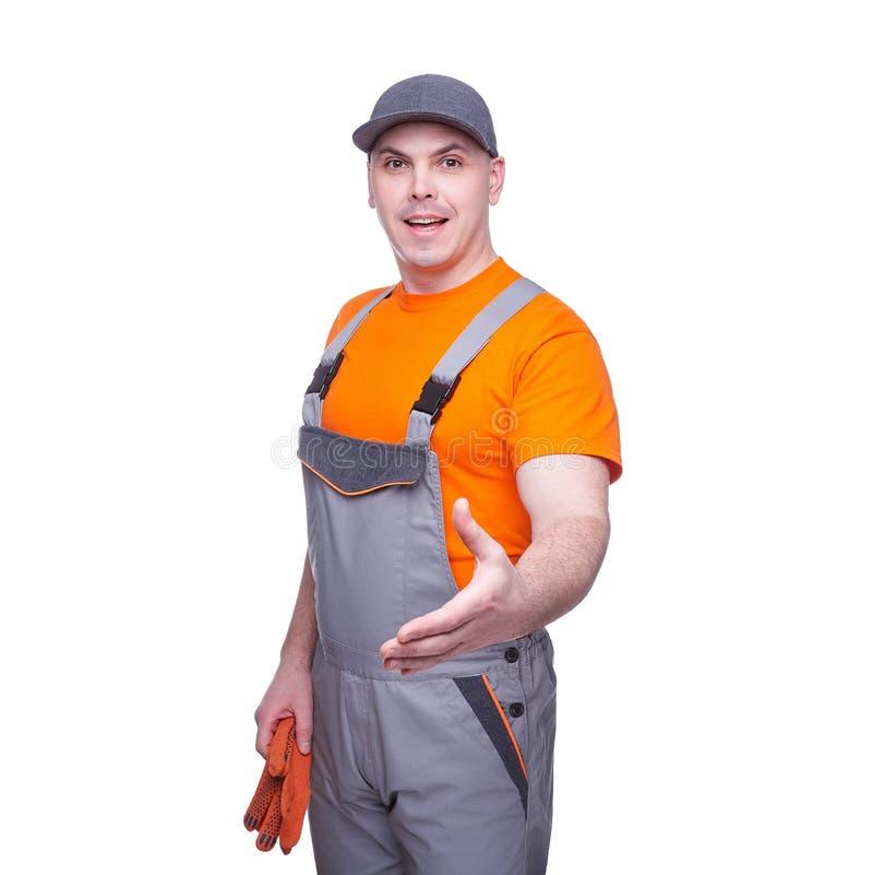 Arbeitskraft in der Uniform bietet einen Händedruck auf weißem Hintergrund an stockfoto