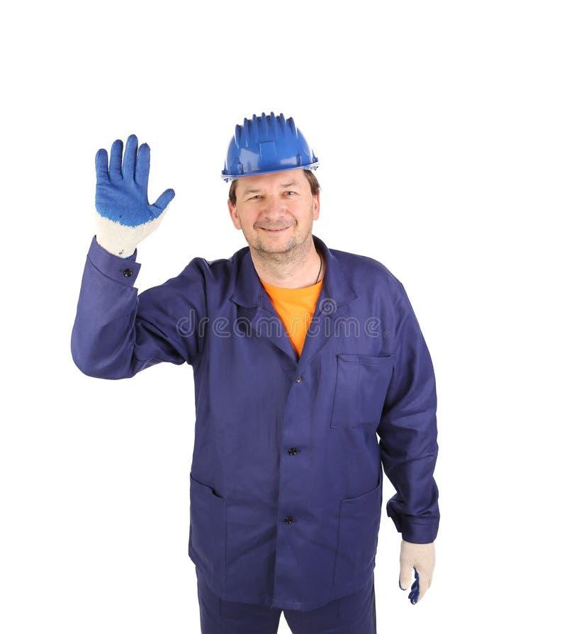 Arbeitskraft, die fünf im Gummihandschuh zeigt stockfoto