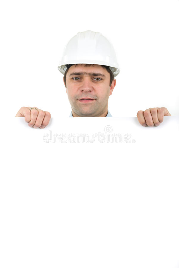 Arbeitskraft, die harten Hut trägt und leere Fahne anhält lizenzfreie stockbilder