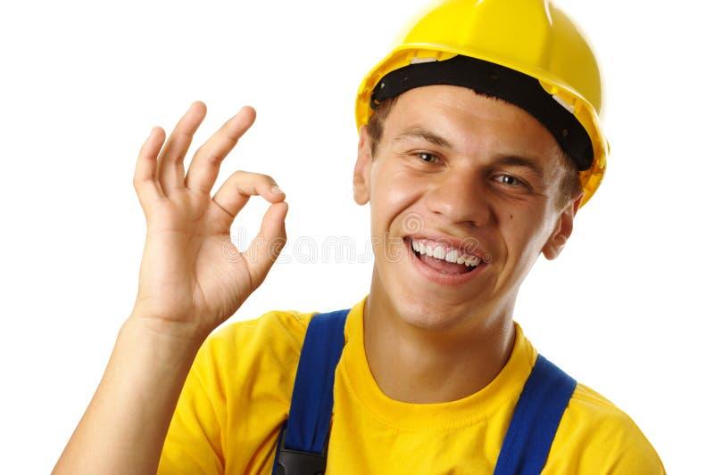 Arbeitskraft, die OKAYzeichen zeigt lizenzfreie stockfotos