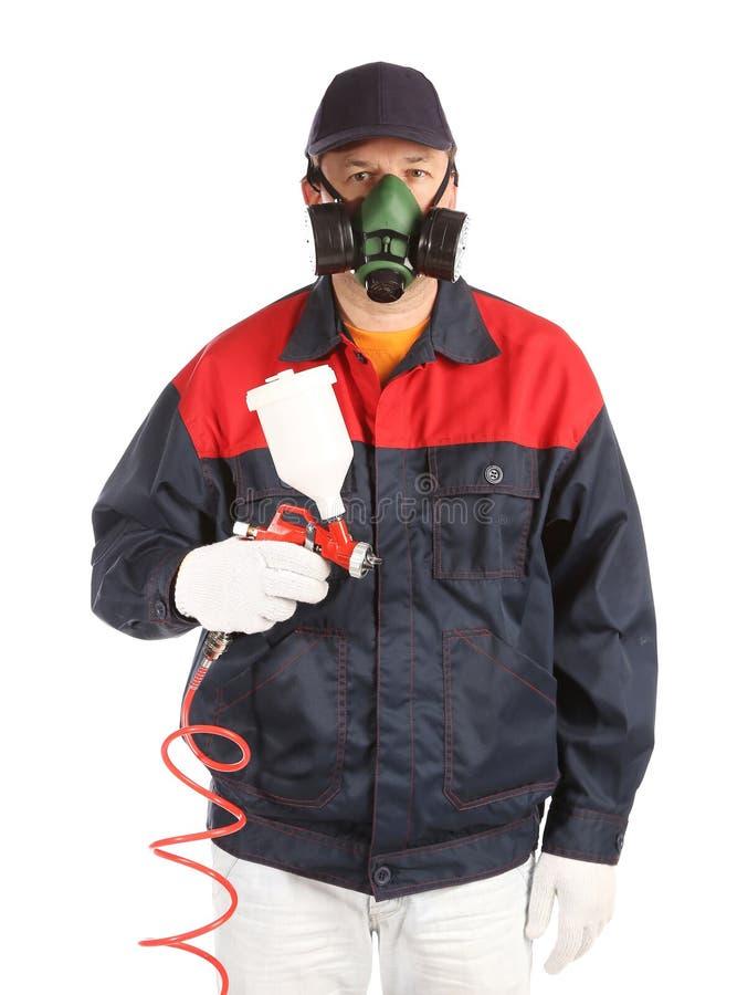 Arbeitskraft im Prozess mit Spray. lizenzfreies stockbild