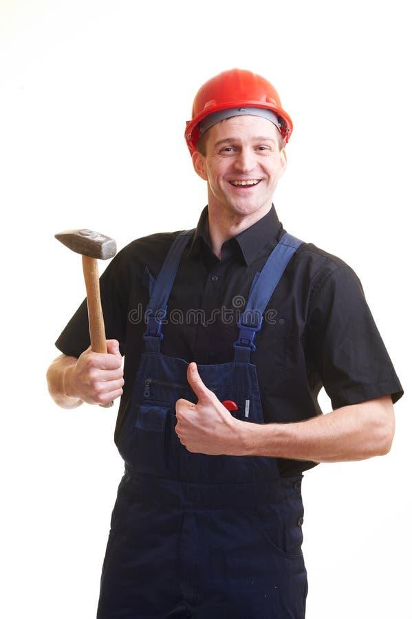 Arbeitskraft im roten harten Hut stockfoto