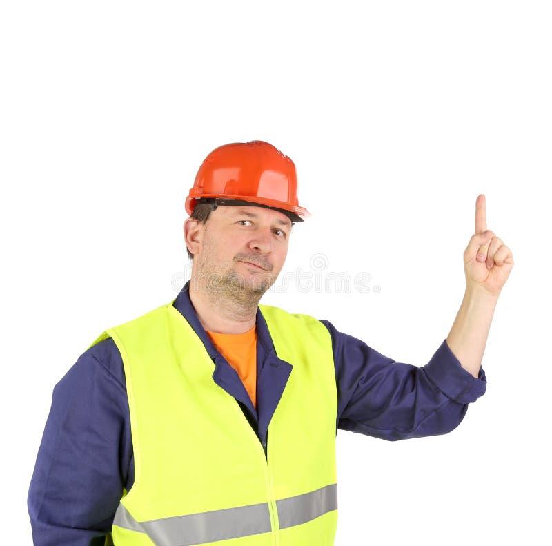 Arbeitskraft im Schutzhelm mit der Hand oben. stockfoto