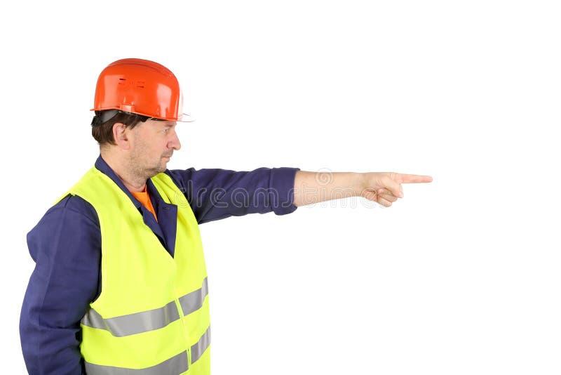 Arbeitskraft im Schutzhelm mit der Hand oben stockbild