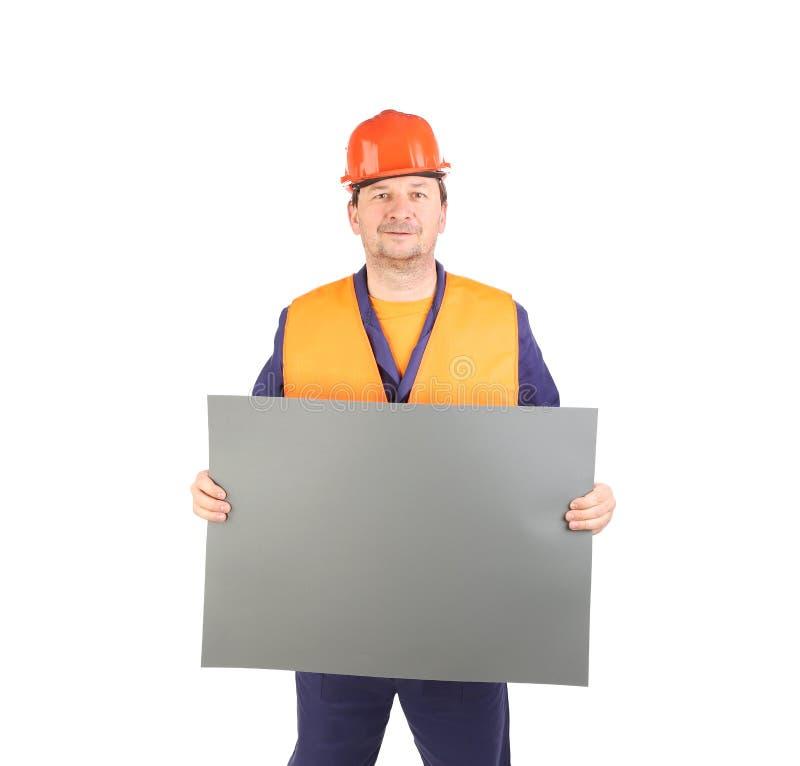 Arbeitskraft im Schutzhelm mit Papier lizenzfreies stockbild