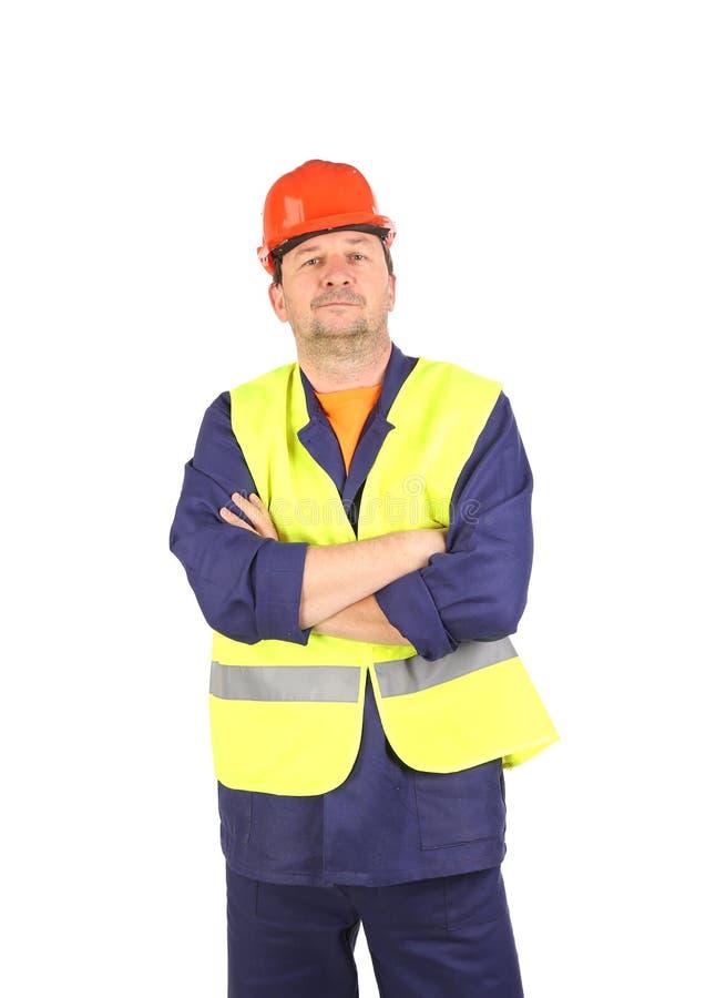 Arbeitskraft im Schutzhelm und in der Weste lizenzfreie stockfotos