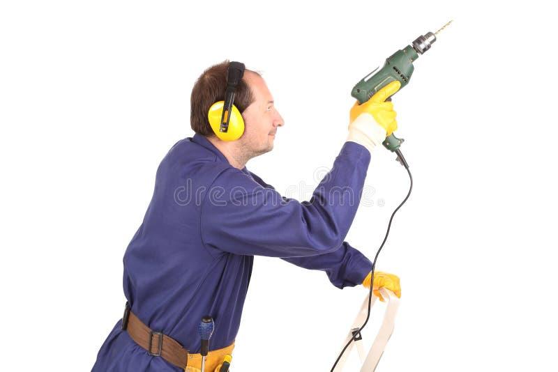 Arbeitskraft mit Bohrgerät. lizenzfreies stockfoto