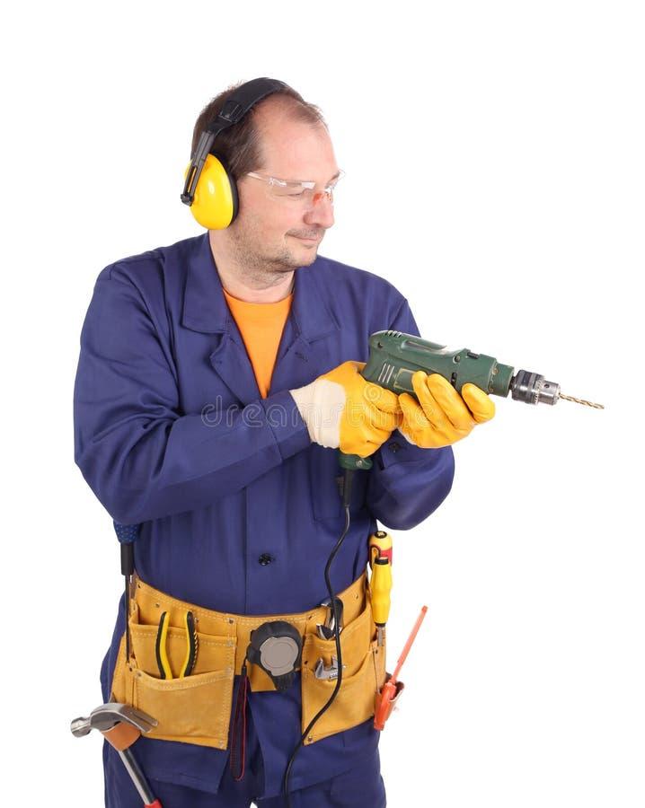 Arbeitskraft mit Bohrgerät lizenzfreies stockbild