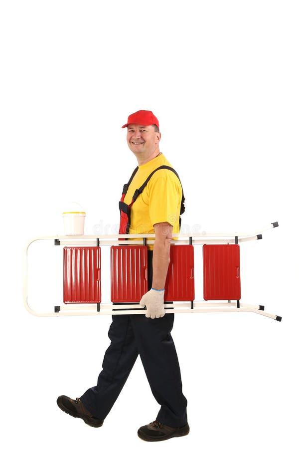 Arbeitskraft mit dem Leiterlächeln. stockfotos