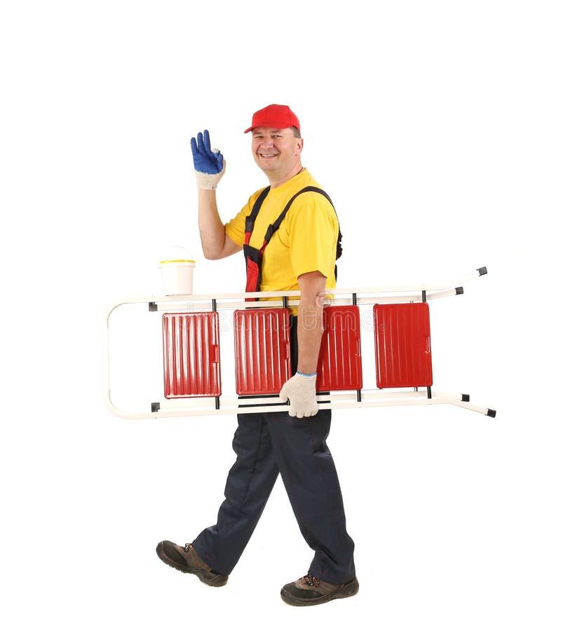 Arbeitskraft mit dem Leiterlächeln lizenzfreies stockfoto