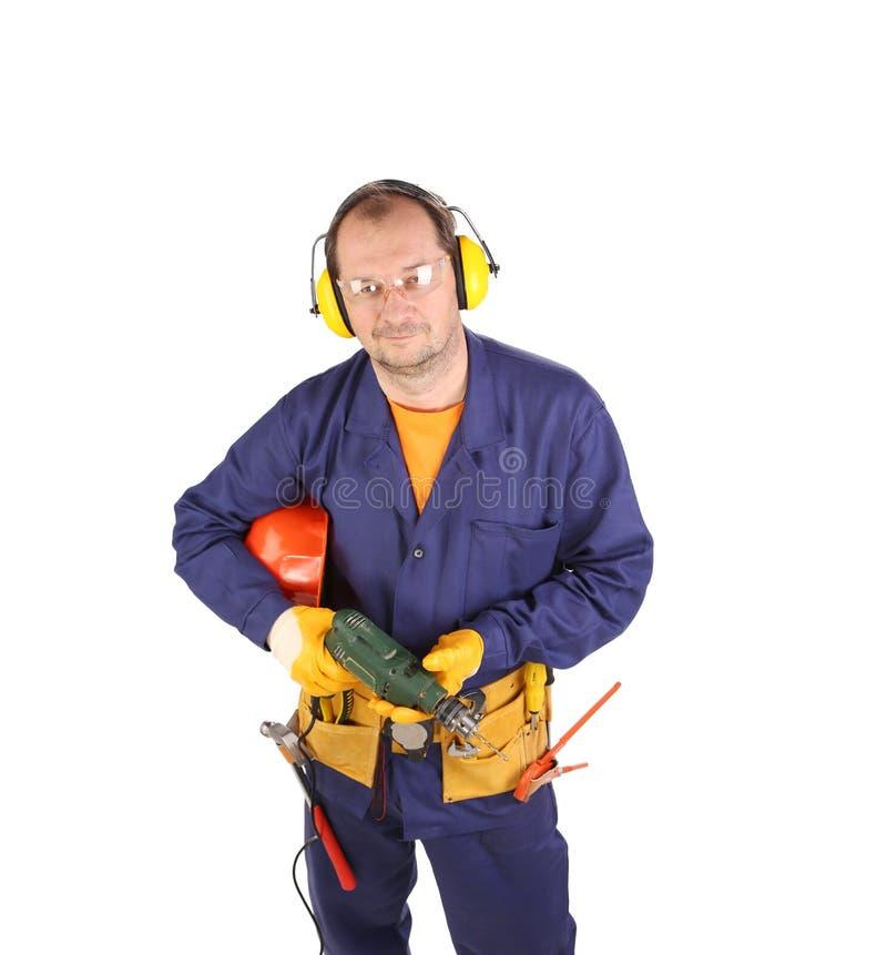 Arbeitskraft mit elektrischer Bohrmaschine lizenzfreies stockbild