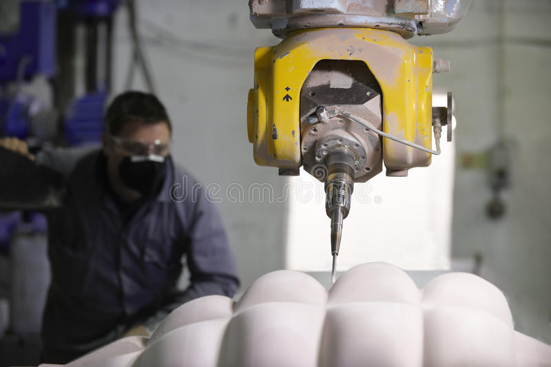 Arbeitskraft und multi Mittellinienmaschine stockfoto