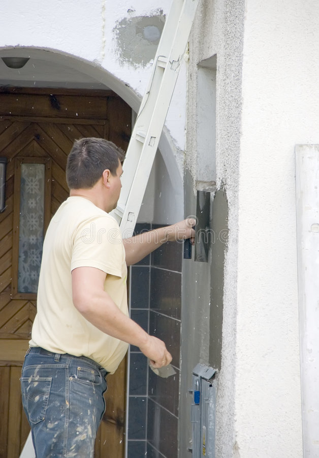 Arbeitskraft und Wand stockfotos
