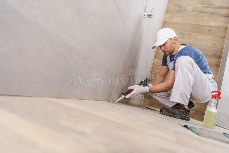 Arbeitskraft-versiegelnde Keramikfliesen lizenzfreie stockfotografie