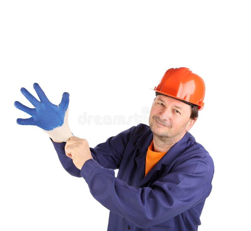Arbeitskraft zeigt Hand im Handschuh. lizenzfreie stockbilder