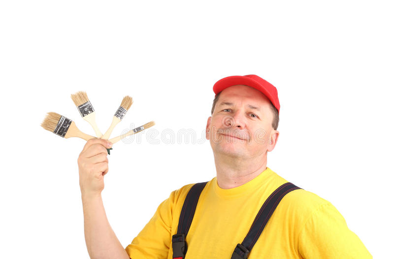 Arbeitskraft zeigt Malereibürsten. stockfotos