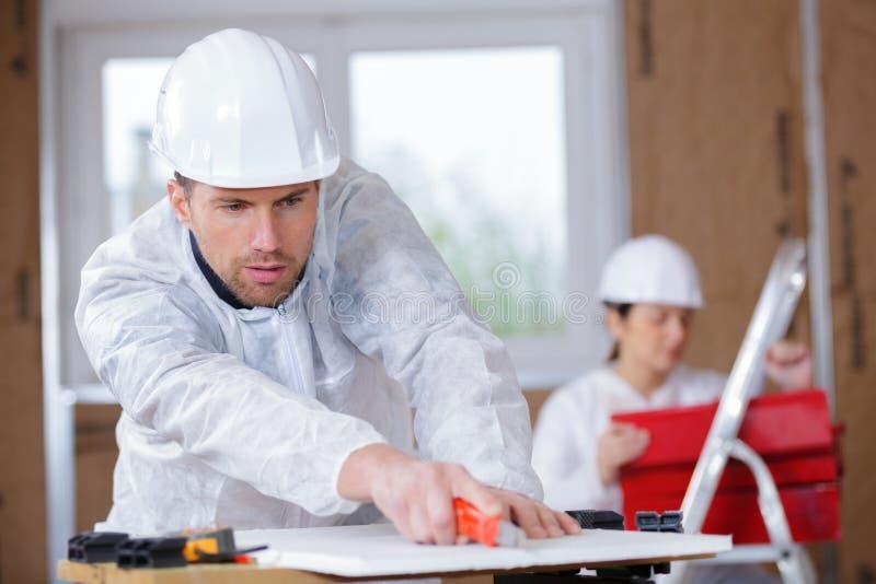 Arbeitskrafterbauer-Ausschnittmaterial stockbild