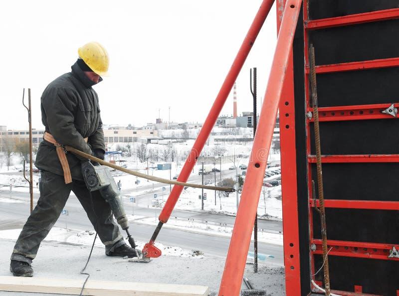 Arbeitskrafterbauer und -beton stockfoto