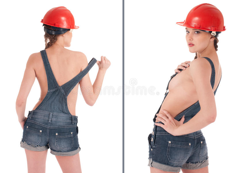 Arbeitskraftfrau im Jeansoverall und im orange Sturzhelm stockfotos