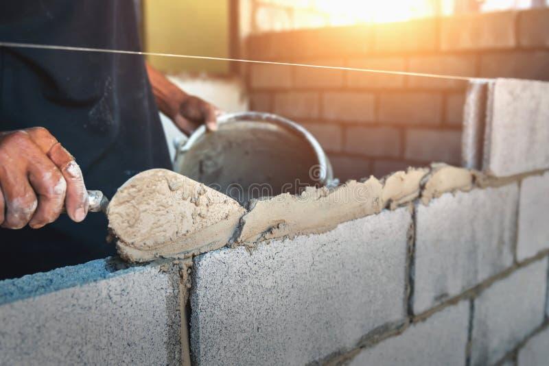 Arbeitskraftgebäude-Wandziegelsteine stockbilder