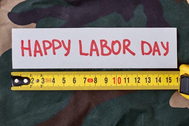 Arbeitstageskarte auf Tarnung lizenzfreies stockbild