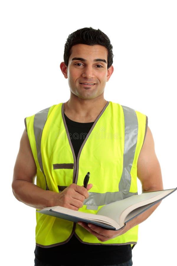 arbetare för bokkonstruktionspenna arkivbild