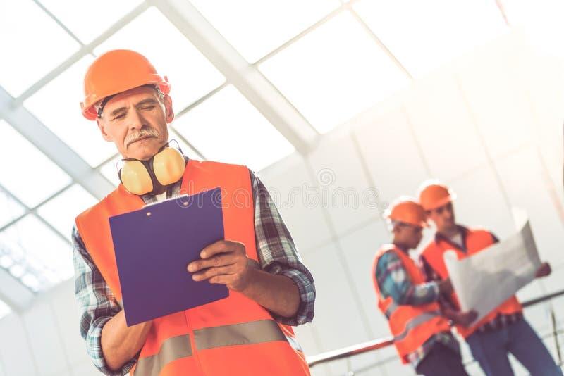 Arbetare för konstruktionsbransch arkivbilder