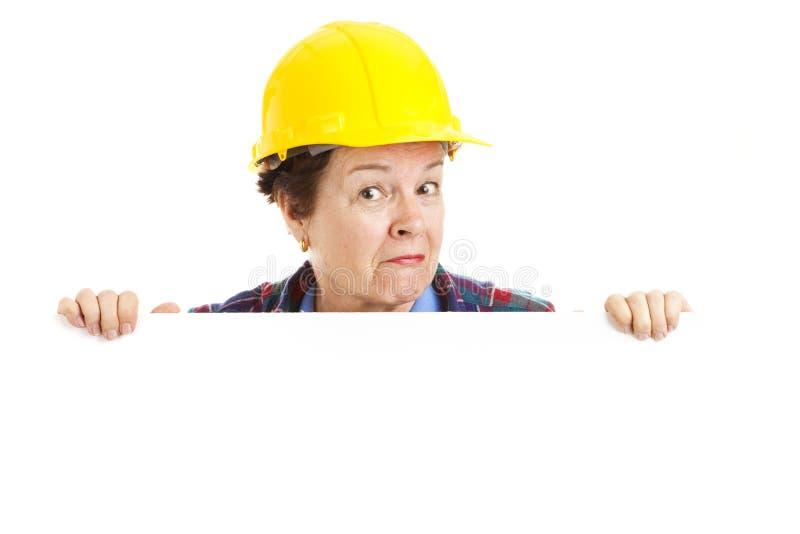 arbetare för konstruktionskvinnligpeekaboo fotografering för bildbyråer