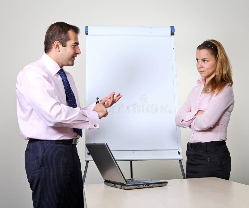 arbetare för kontorspresentation två arkivfoto