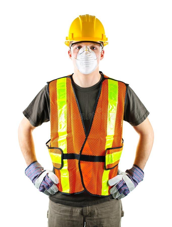 arbetare för säkerhet för konstruktionsutrustning slitage royaltyfria foton