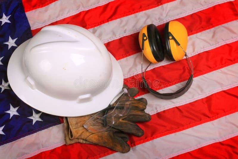 Arbetskugghjul av den amerikanska arbetaren för blå krage arkivfoto