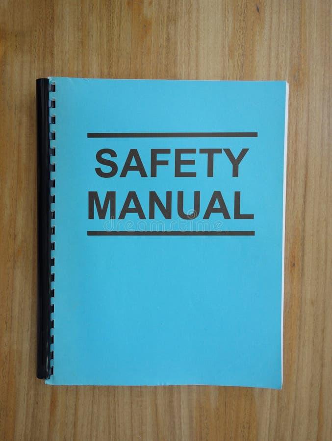 Arbetsplatssäkerhetshandbok arkivbild