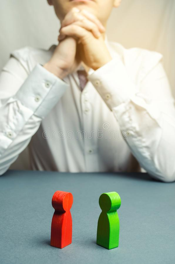 The arbitrator examines the conflict situation between people. Search for solutions and compromises. Court and law. Justice. Verdict. Legal support. Conflict royalty free stock image