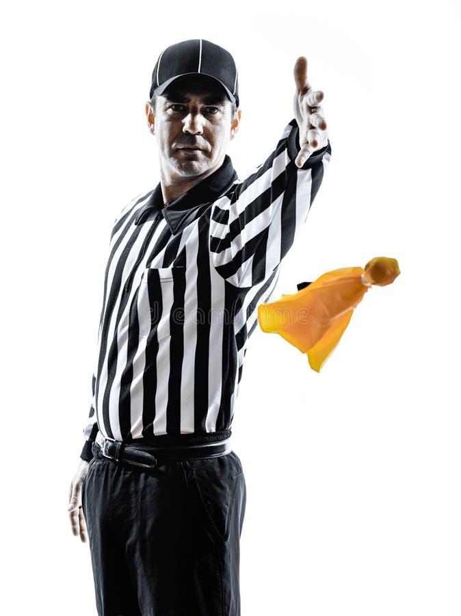Arbitro di football americano che getta le siluette della bandiera gialla fotografie stock