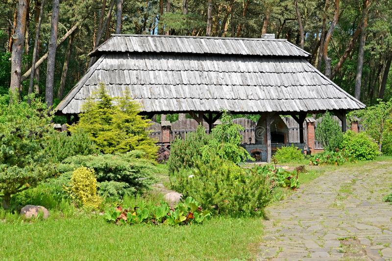Arbor grill on the seasonal dacha in summer sunny day.  royalty free stock images