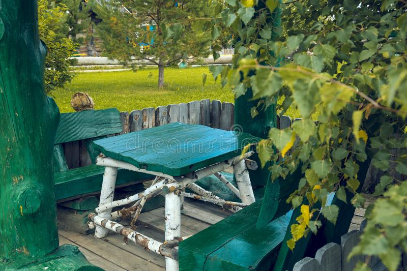 Arbor in wood with two benches and a table royalty free stock photography