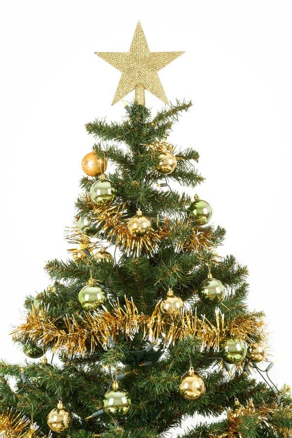 Arbre de Noël décoré avec les billes jaunes et vertes image stock