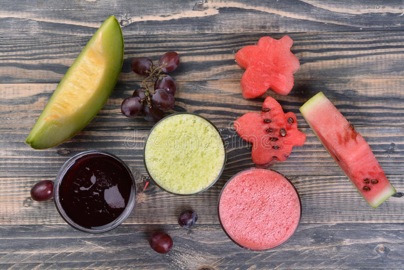 Arbuz, melon i gronowy sok, obrazy stock