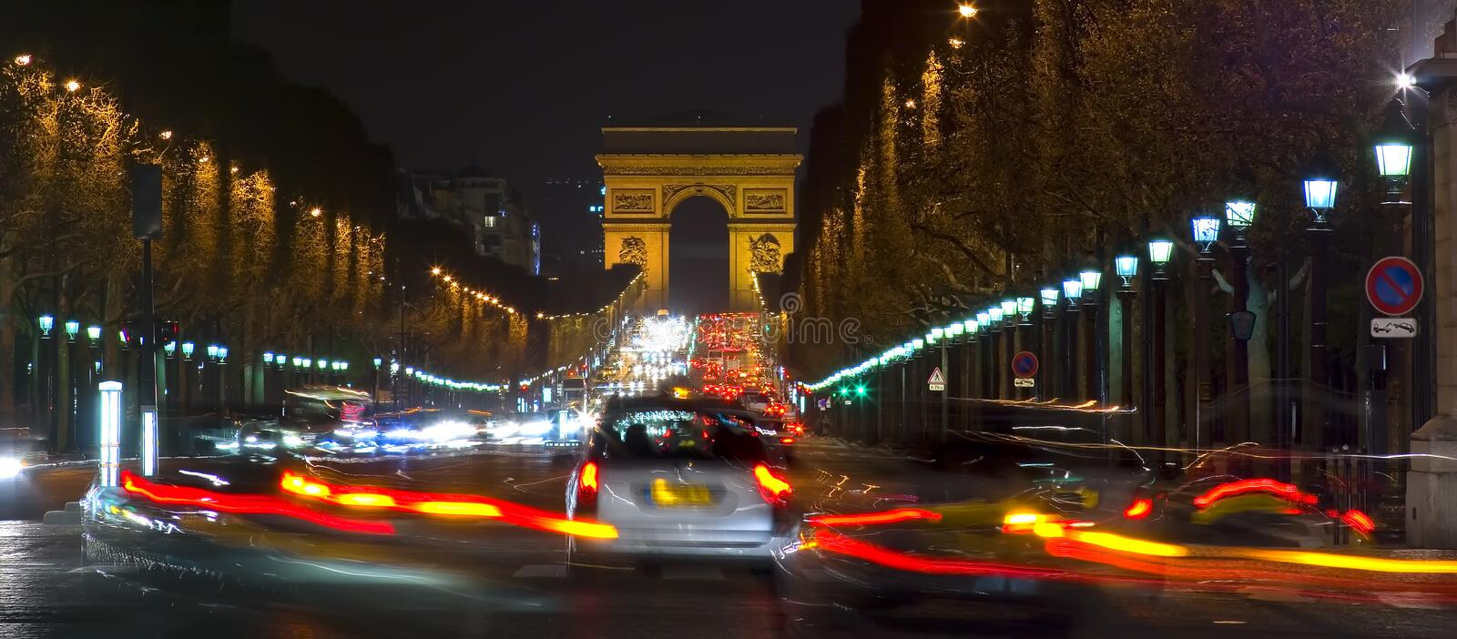 Arc de Triomphe and Champs Elysees, Paris, France. Creative night photograph in letterbox format of cars speeding along the Champs Elysees towards the Arc De stock photos