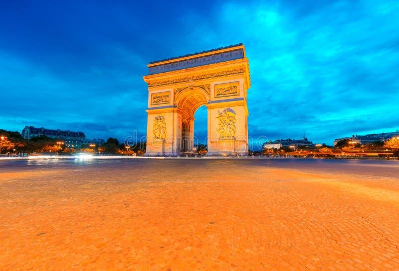 Arc de Triomphe illuminated at night, Paris royalty free stock images