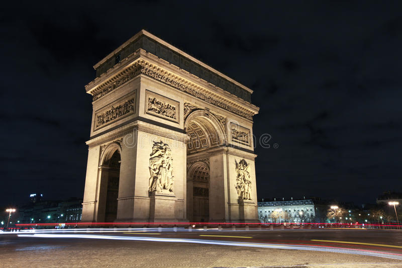 Arc de Triomphe at night Paris stock images