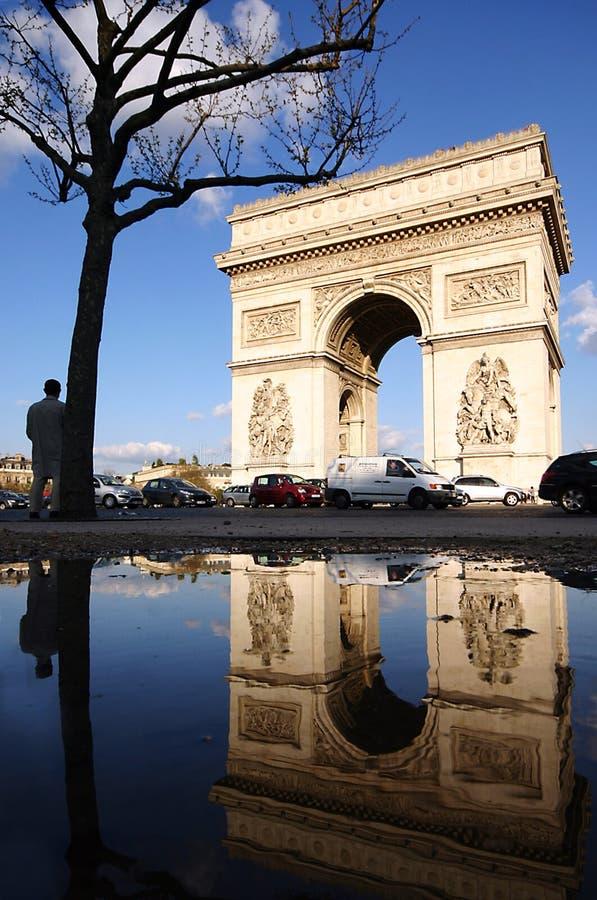 Arc de Triomphe after rain. Arc de triomphe de l'Étoile after rain stock photo