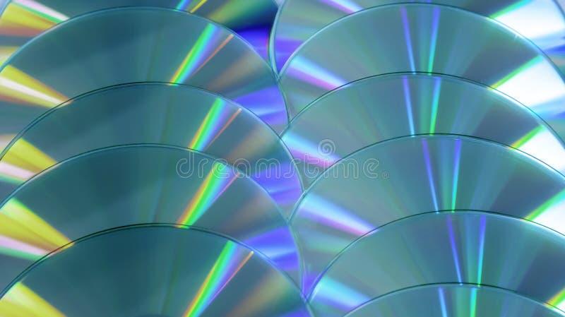 Arc-en-ciel compact coloré de fond de disque du CD DVD briller le blanc jaune bleu ultra photo libre de droits