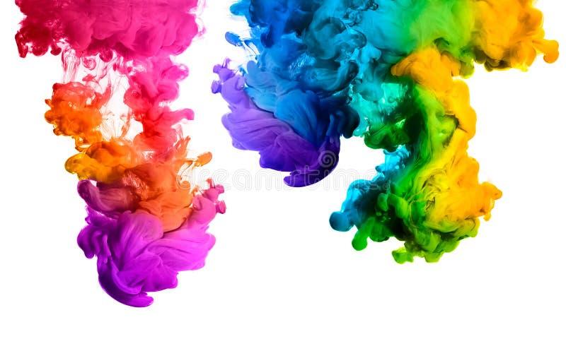 Arc-en-ciel d'encre acrylique dans l'eau Explosion de couleur photos stock
