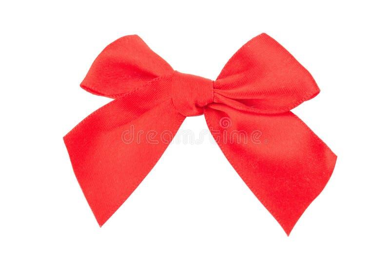 Arc en soie de cadeau de ruban rouge d'isolement sur le fond blanc image libre de droits