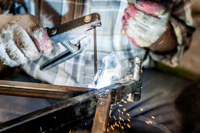 Arc flash welding with sparkles close up stock images